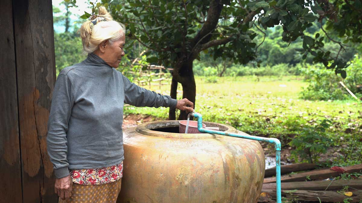 Elderly woman showing her tapper water